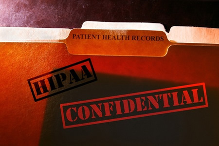 Patient records file stamped with HIPAA and CONFIDENTIAL on it
